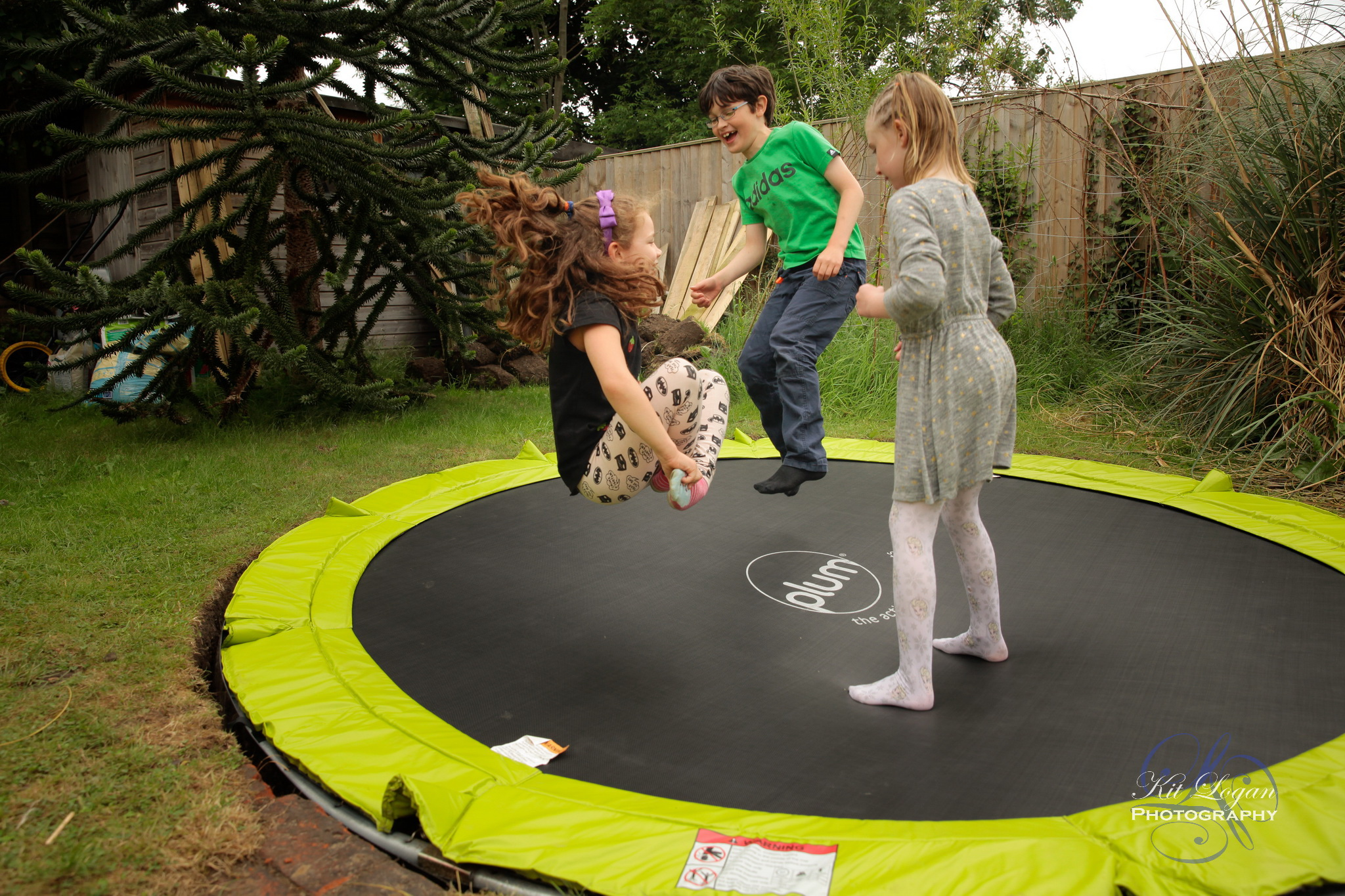 Children on trampoline playing popcorn