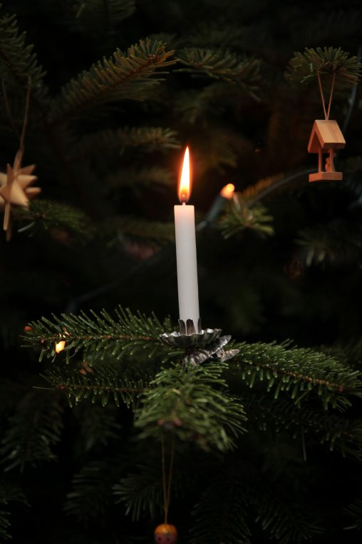 Lighted candle on a Christmas tree