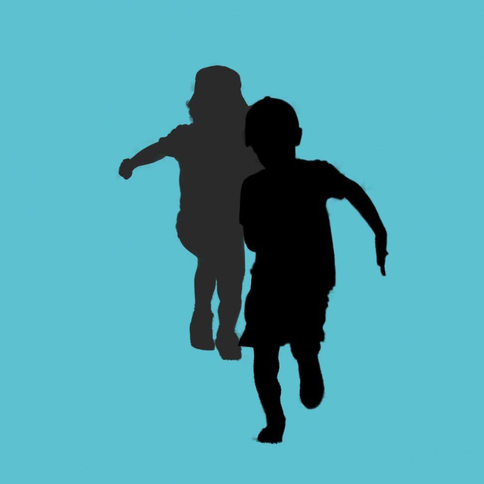 silhouette of children running