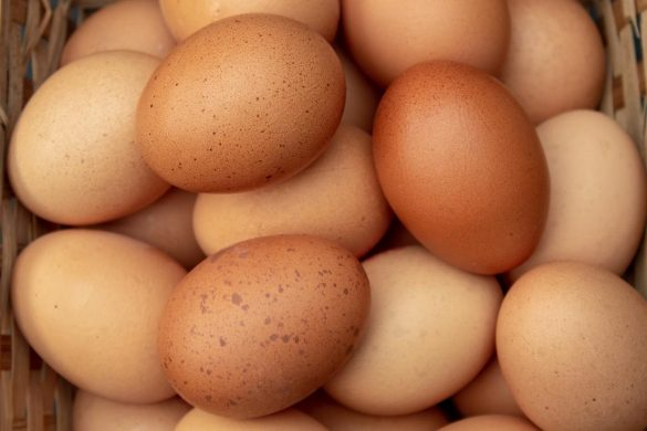 pale and brown eggs in a basket